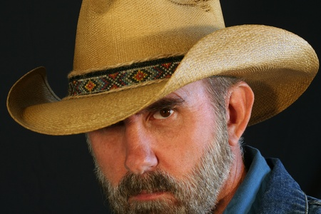 A Bearded Cowboy Against Black Peers with One Eye photo
