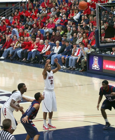 foul: A Foul Shot by Jesse Perry in a University of Arizona Wildcats Mens Basketball Game Against the Robert Morris Colonials at McKale Center, Tucson, on December 22, 2010. Also Solomon Hill, Russell Johnson, Gary Wallace.