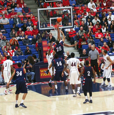 center court: A Blocked Shot by Derrick Williams in a University of Arizona Wildcats Mens Basketball Game Against the Robert Morris Colonials at McKale Center, Tucson, on December 22, 2010. Also Kevin Parrom, Solomon Hill, Brendon Lavender, Russell Johnson, Yann Charl