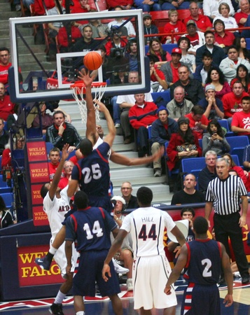 A Blocked Shot by Derrick Williams in a University of Arizona Wildcats Men's Basketball Game Against the Robert Morris Colonials at McKale Center, Tucson, on December 22, 2010. Also Solomon Hill, Yann Charles, Gary Wallace and Velton Jones.