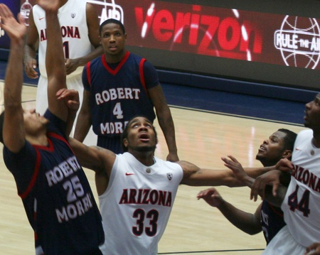A Battle Under the Net in a University of Arizona Wildcats Men's Basketball Game Against the Robert Morris Colonials at McKale Center, Tucson, on December 22, 2010. Jesse Perry, Solomon Hill, Yann Charles, Karon Abraham, Coron Williams. Stock Photo - 8540957