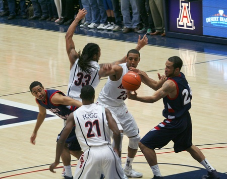 kyle: A Battle for the Ball in a University of Arizona Wildcats Mens Basketball Game Against the Robert Morris Colonials at McKale Center, Tucson, on December 22, 2010. Kyle Fogg, Jesse Perry, Derrick Williams, Lawrence Bridges.