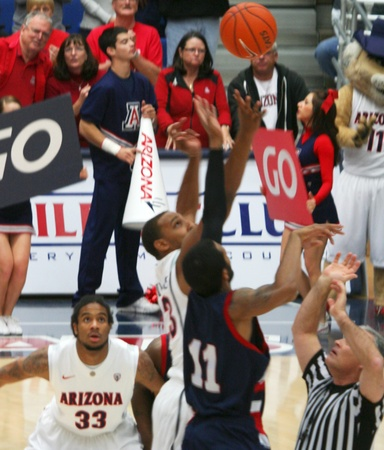 A Tipoff in a University of Arizona Wildcats Mens Basketball Game Against the Robert Morris Colonials at McKale Center, Tucson, on December 22, 2010. Jesse Perry, Derrick Williams, Lijah Thompson.