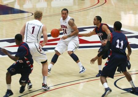 A Guard, Brendon Lavender, in a University of Arizona Wildcats Men's Basketball Game Against the Robert Morris Colonials at McKale Center, Tucson, on December 22, 2010. Kyryl Natyazhko, Coron Williams, Lijah Thompson. Stock Photo - 8577359