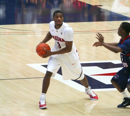 A Defender Bothers Kevin Parrom in a University of Arizona Wildcats Mens Basketball Game Against the Robert Morris Colonials at McKale Center, Tucson, on December 22, 2010.