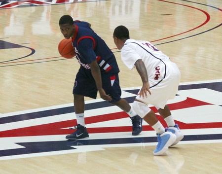 defended: Anthony Myers defended by Lamont Jones in a University of Arizona Wildcats Mens Basketball Game Against the Robert Morris Colonials at McKale Center, Tucson, on December 22, 2010.