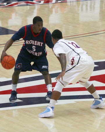 morris: Anthony Myers defended by Lamont Jones in a University of Arizona Wildcats Mens Basketball Game Against the Robert Morris Colonials at McKale Center, Tucson, on December 22, 2010.
