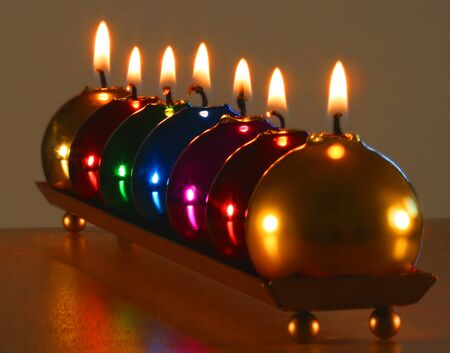 A Line of Seven Burning Christmas Ornament Candles Zdjęcie Seryjne