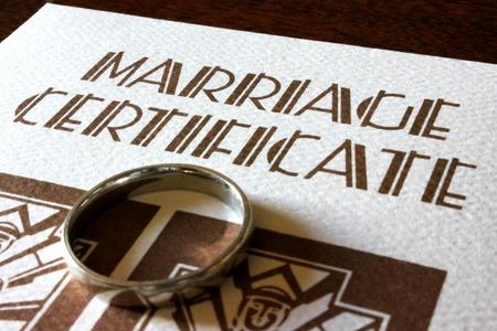 marriage certificate: A Marriage Certificate and White Gold Wedding Ring