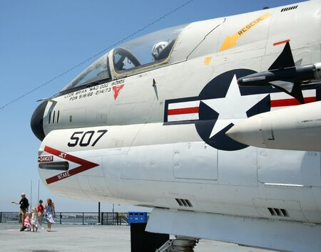A Tourist Family and an A-7 Corsair II on the Flight Deck of the USS Midway Museum, San Diego, California, taken July 15, 2009