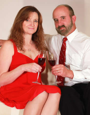 A Husband and Wife Toast with Red Wine on Valentine's Day Stock Photo - 8854551