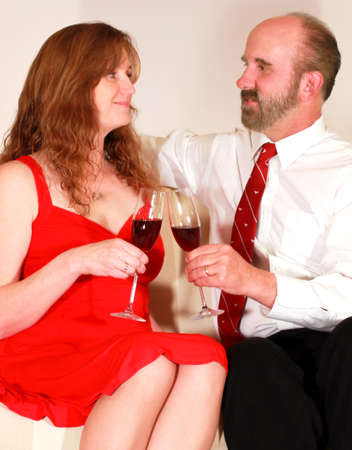sexy wife: A Husband and Wife Toast with Red Wine on Valentines Day Stock Photo