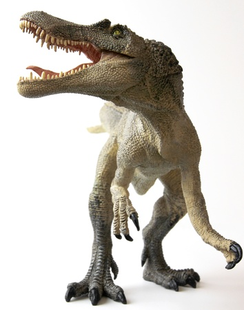 dinosaur teeth: A Spinosaurus Dinosaur with Gaping Jaws Full of Sharp Teeth