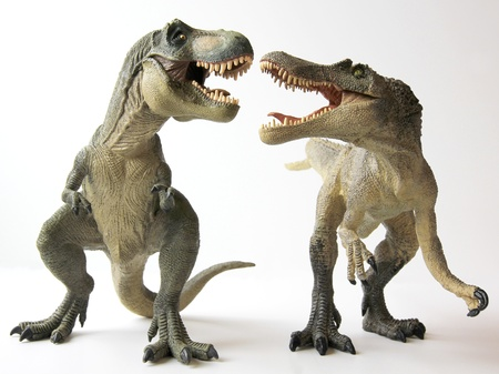 tyrannosaurus rex: A Tyrannosaurus Rex Dinosaur Battles with a Spinosaurus