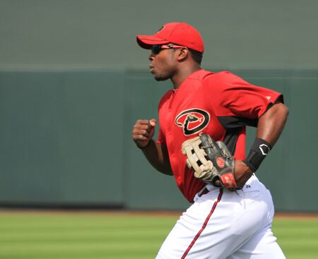 outfielders: Arizona Diamondbacks Right Fielder Juston Upton Running in a 2011 Spring Training game against the Cincinnati Reds at Salt River Fields at Talking Stick, Scottsdale, on March 19