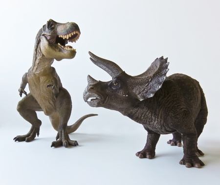 tyrannosaurus: A Triceratops and Tyrannosaurus Rex Battle Against a White Background