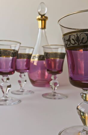 crystal bowl: A Wine Decanter and Set of Four Glasses Fashioned in Iraq