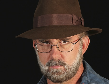 bearded wire: A Bearded Man in SIlver Wire Frame Glasses and a Brown Fedora