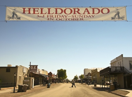 gunfights: Tombstone, Arizona - October 22: Allen Street on October 22, 2011, in Tombstone, Arizona. A Helldorado banner welcomes tourists to historic Allen Street where gunfights and barroom brawls are staged during this annual celebration of the Old West.