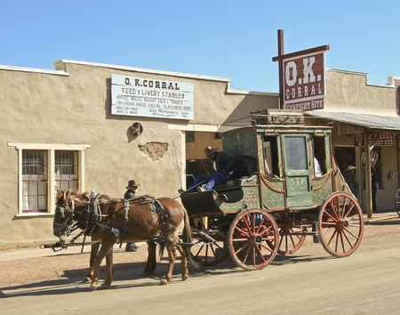 corral: Tombstone, Arizona - October 22: Allen Street on October 22, 2011, in Tombstone, Arizona. A stagecoach welcomes tourists to historic Allen Street and the OK Corral where gunfights and barroom brawls are staged during th annual Helldorado celebration of th Editorial