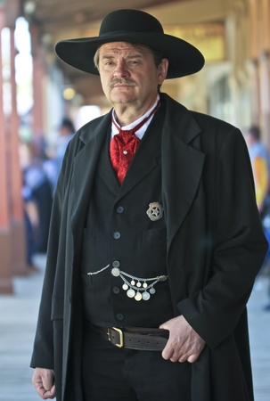 Tombstone, Arizona - October 22: Allen Street on October 22, 2011, in Tombstone, Arizona. A Helldorado participant dressed in period costume as Wyatt Earp welcomes tourists to historic Allen Street where gunfights and barroom brawls are staged during this