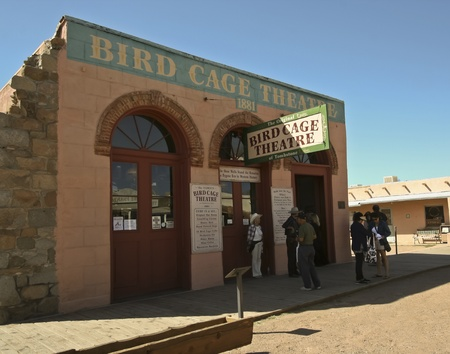 gunfights: Tombstone, Arizona - October 22: Allen Street on October 22, 2011, in Tombstone, Arizona. The famous Bird Cage Theatre welcomes tourists to historic Allen Street where gunfights and barroom brawls are staged during this annual celebration of the Old West. Editorial
