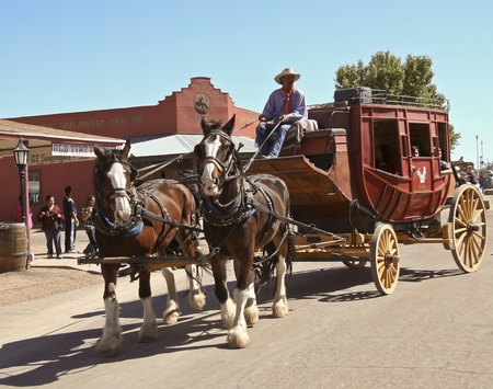 gunfights: Tombstone, Arizona - October 22: Allen Street on October 22, 2011, in Tombstone, Arizona. A Helldorado stagecoach welcomes tourists to historic Allen Street where gunfights and barroom brawls are staged during this annual celebration of the Old West.