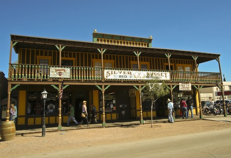 gunfights: Tombstone, Arizona - October 22: Allen Street on October 22, 2011, in Tombstone, Arizona. The Silver Nugget Bed and Breakfast welcomes tourists to historic Allen Street where gunfights and barroom brawls are staged during this annual celebration of the Ol
