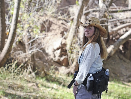 An Attractive Long Haired Woman Hiking in a Cowboy Hat Stock Photo - 11066785