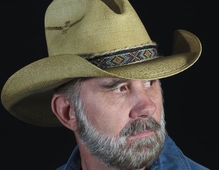 A Man with Brown Eyes and a Gray Beard in a Straw Cowboy Hat with a Beaded Band photo
