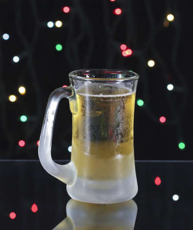 icey: A Frosty Mug of Amber Beer on a Dark Christmas Eve Stock Photo