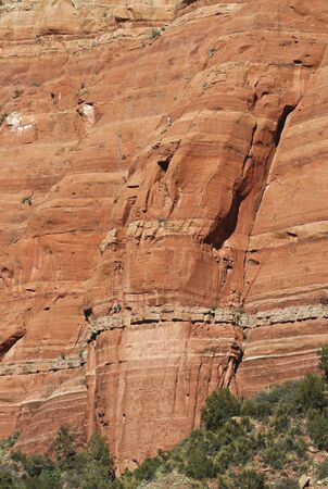 A Team of Four Rock Climbers Ascend a Red Sandstone Cliff Stock Photo - 11595197
