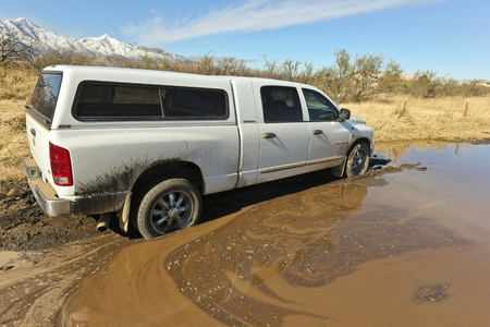 Cochise County, Arizona - December 14: An unnamed dirt road on December 14, 2011, Cochise County, Arizona. Winter flooding from summer wildfires turns dirt roads into mud quagmires trapping vehicles like this Dodge Ram.