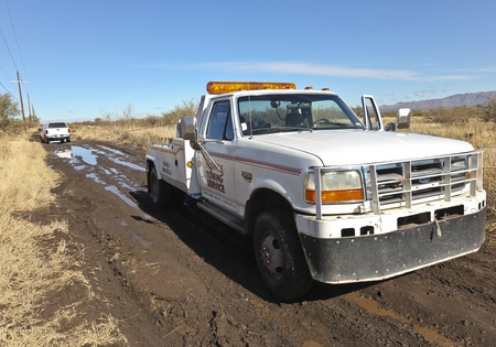 Cochise County, Arizona - December 14: An unnamed dirt road on December 14, 2011, Cochise County, Arizona. Winter flooding from summer wildfires turns dirt roads into mud quagmires trapping vehicles and requiring rescues by tow trucks.
