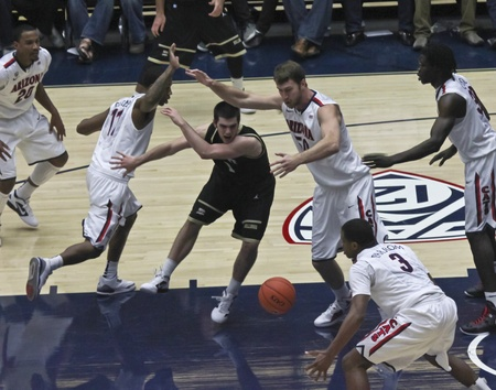 bryant: TUCSON, ARIZONA - DECEMBER 22: MCKALE ARENA on DECEMBER 22, 2011, in TUCSON, ARIZONA. The University of Arizona Wildcats vs. Bryant. A battle for the ball in the paint. Editorial