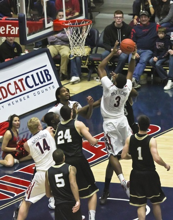 layup: TUCSON, ARIZONA - DECEMBER 22: MCKALE ARENA on DECEMBER 22, 2011, in TUCSON, ARIZONA. The University of Arizona Wildcats vs. Bryant. An airborne Kevin Parrum. Editorial