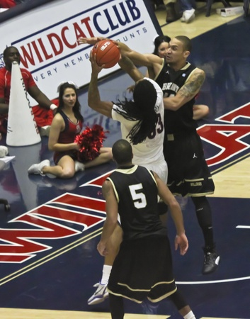 bryant: TUCSON, ARIZONA - DECEMBER 22: MCKALE ARENA on DECEMBER 22, 2011, in TUCSON, ARIZONA. The University of Arizona Wildcats vs. Bryant. A fouled Jesse Perry. Editorial
