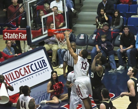 TUCSON, ARIZONA - DECEMBER 22: MCKALE ARENA on DECEMBER 22, 2011, in TUCSON, ARIZONA. The University of Arizona Wildcats vs. Bryant. A slam dunk by Nick Johnson.