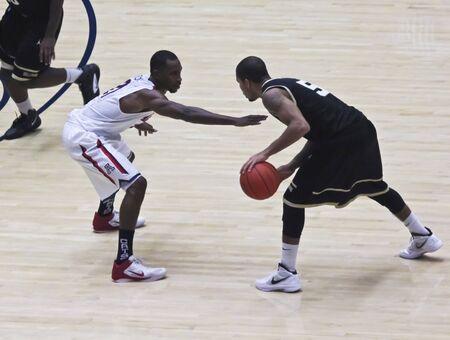 defensive: TUCSON, ARIZONA - DECEMBER 22: MCKALE ARENA on DECEMBER 22, 2011, in TUCSON, ARIZONA. The University of Arizona Wildcats vs. Bryant. A defensive Kyle Fogg. Editorial