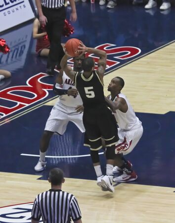kyle: TUCSON, ARIZONA - DECEMBER 22: MCKALE ARENA on DECEMBER 22, 2011, in TUCSON, ARIZONA. The University of Arizona Wildcats vs. Bryant. A defense by Fogg and Hill. Editorial