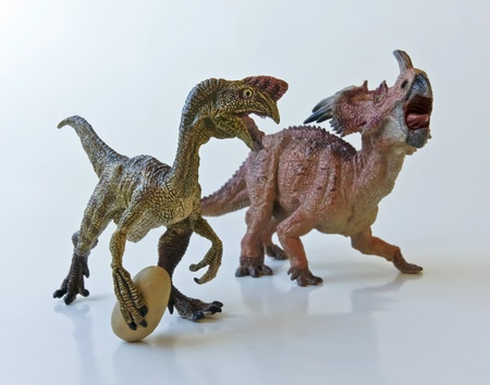 An Oviraptor steals an egg from a Styracosaurus mother
