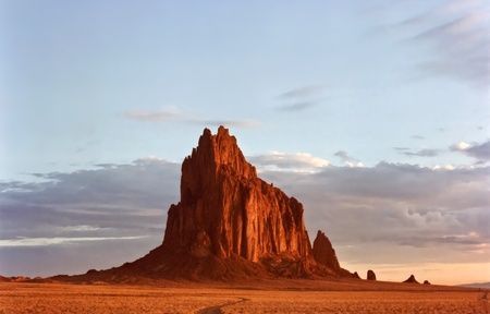 A Fery Shiprock, New Mexico, Rises From the Desert Plain Just After Dawn