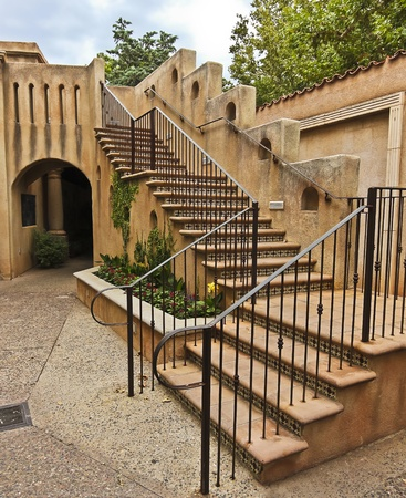 sedona: A Courtyard Staircase in Spanish-Colonial Architecture at Tlaquepaque in Sedona, Arizona, on July 26, 2011. Editorial