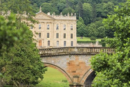 chatsworth: Derbyshire, Great Britain - July 4: Chatsworth House on July 4, 2012, in Derbyshire, Great Britain. Chatsworth House is one of Britains most stately homes and biggest tourist draws. Editorial