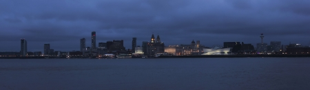 liverpool: Liverpool glitters at night, from across the Mersey River. Liverpool landmarks The Royal Liver Building, Museum of Liverpool, Merseyside, Cunard Building and Port of Liverpool Building can be seen. Stock Photo