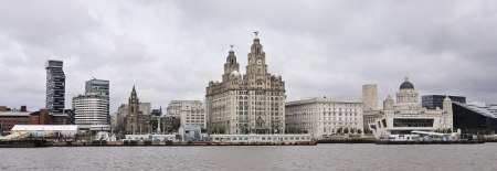 mersey: Liverpool, England - July 9: Pier Head, from across the Mersey River, on July 9, 2012 in Liverpool, England. Liverpool landmarks include The Royal Liver Building, Merseyside, Cunard Building, Port of Liverpool Building, and Georges Landing Stage.