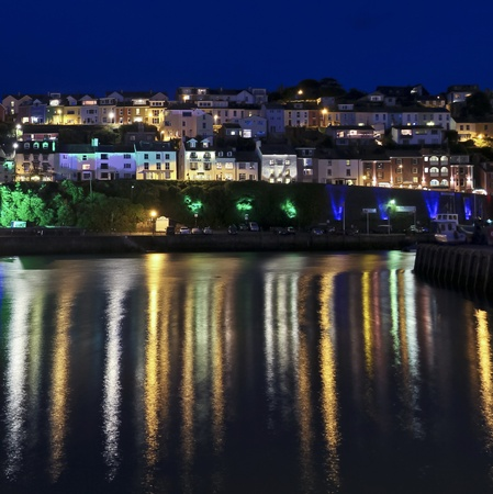 devon: A Look at the Buildings, Lights and Reflections of Brixham, England, at Night Stock Photo