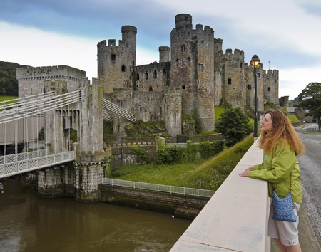Conwy, Wales - July 16: Conwy Castle on July 16, 2012, in Conwy, Wales. As evening falls, the lights come on on the bridge to Conwy Castle. Stock Photo - 14987222