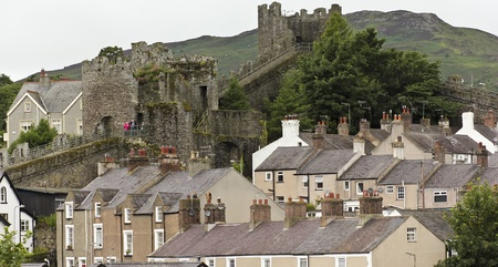 Conwy, Wales - July 17: Conwy City Wall on July 17, 2012, in Conwy, Wales. As evening falls, a family walks the city walls surrounding Conwy, Wales.