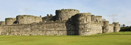 Beaumaris, Wales - July 21: Beaumaris Castle on July 21, 2012, in Anglesey, Wales. The lawn at Beaumaris Castle, a popular tourist destination.